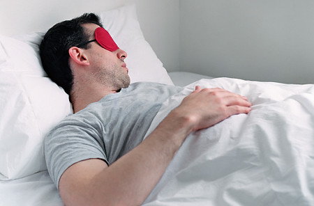 Man sleeping, wearing eye mask   Original Filename: 200026281-002.jpg